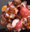 Semi-precious Mookaite beads in ring form