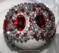 Ball with red cabochons