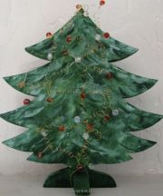 Wood fir tree decorated with beads