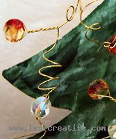 The fir tree - the white and red beads side