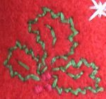 Embroidered holly leaves design