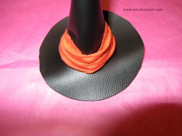 sewing ribbon on the hat