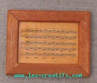 Small wood picture frame with music score