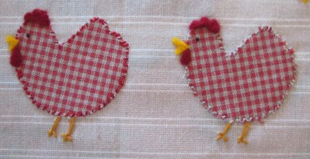 Fabric and embroidery chicken design on fabric background