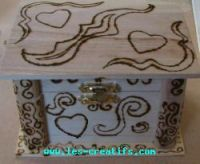 Pokerwork design on wooden jewelry box