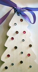 Miniature wooden fir tree with pink rhinestones