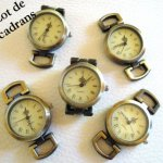 5 antique bronze watch faces